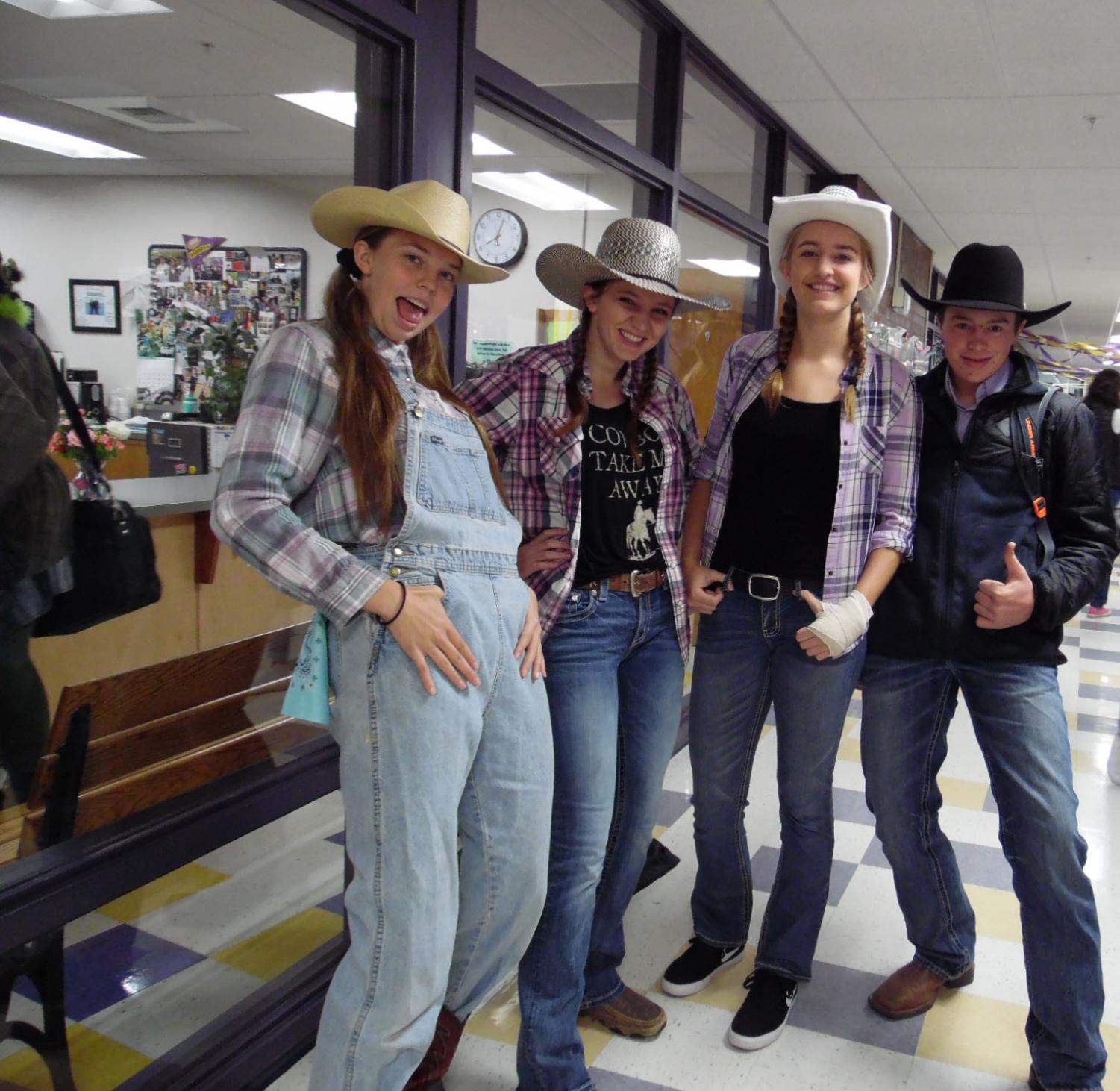 Howdy, pardners! Sisters Ryleah and Rainna Floyd join Abby Kokot and McClain Payne outside the attendance office on Cowboys versus Dinosaurs dress up day.