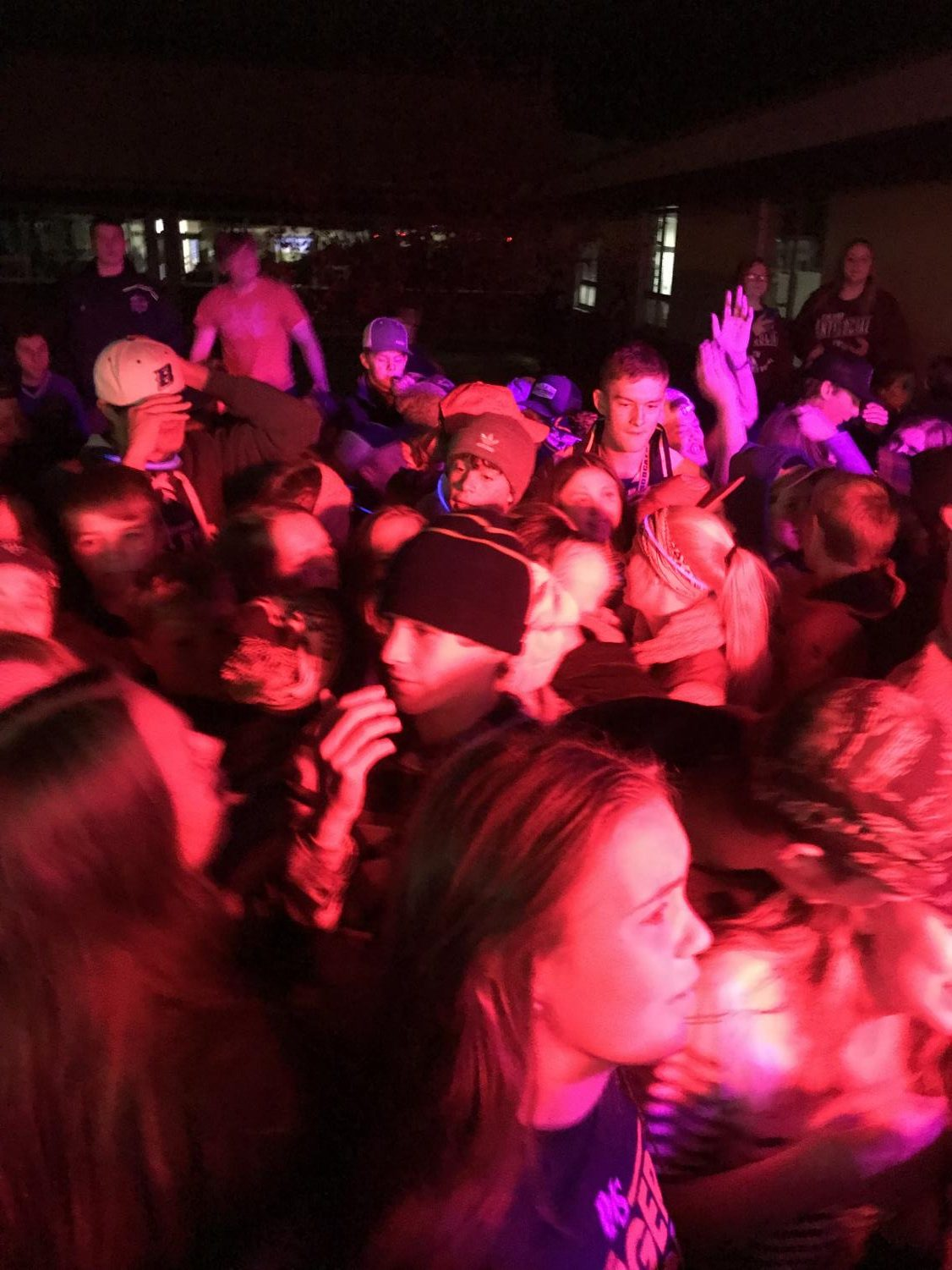 Students are bathed in the purple light as they dance to Thrift Shop by MackelMore