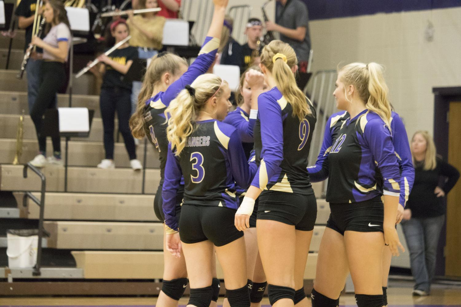 The lady Rangers huddle together during the second match of Tuesday's home game.
