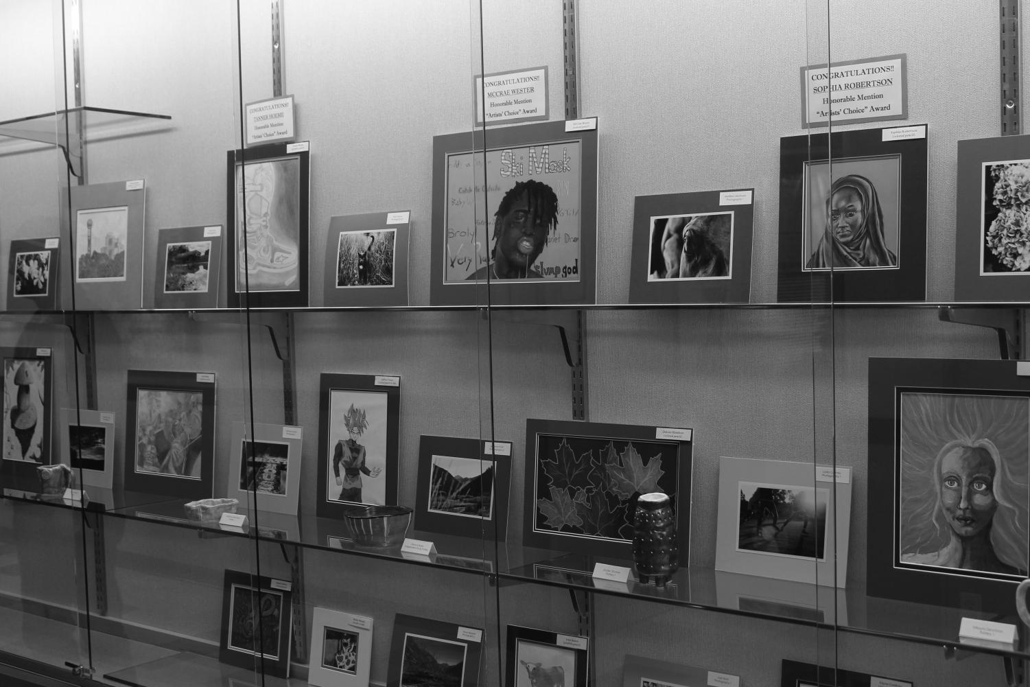 Display cases showing the art pieces that made it into the first art show.