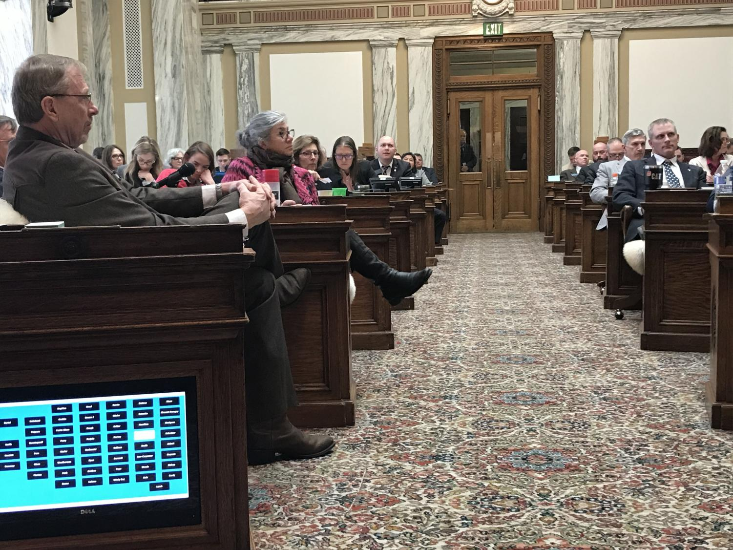 Local House representative, Laurie Bishop (second row), listens to a bill being introduced to the group. The screen in the lower left is to indicate a need for a page, like a flight attendant.