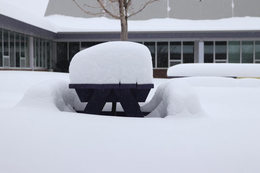 A+picnic+table+in+the+courtyard+is+gradually+disappearing+in+a+pile+of+snow%2C+Monday.