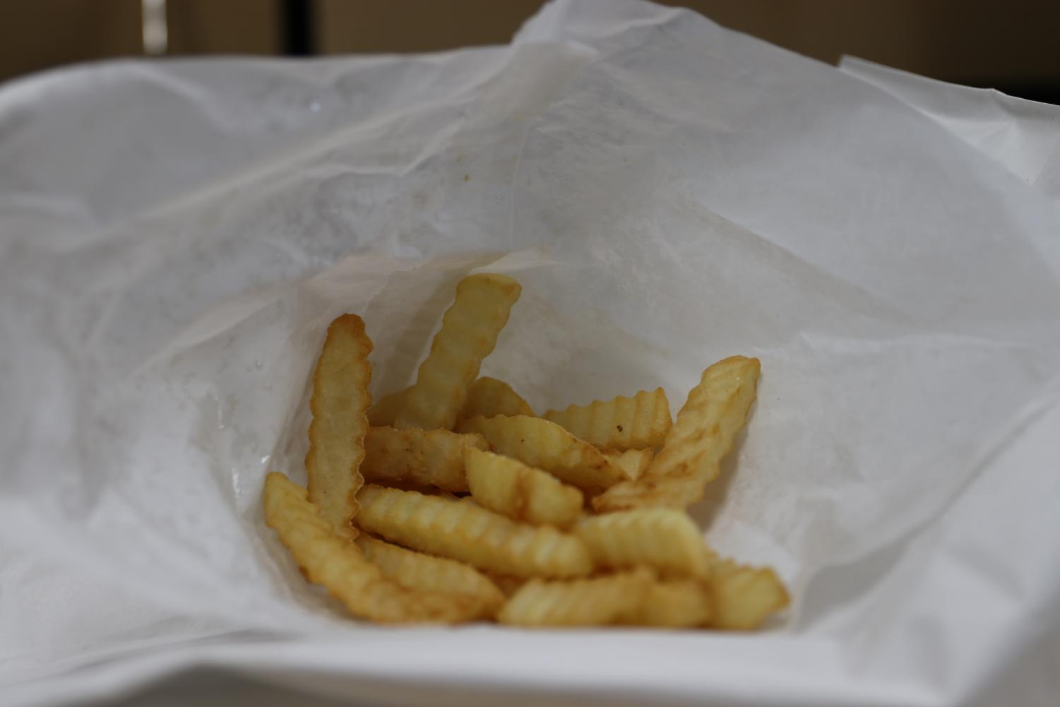 French fries from Mark's In and Out, at right, are cheap and classic, but nothing to get excited about