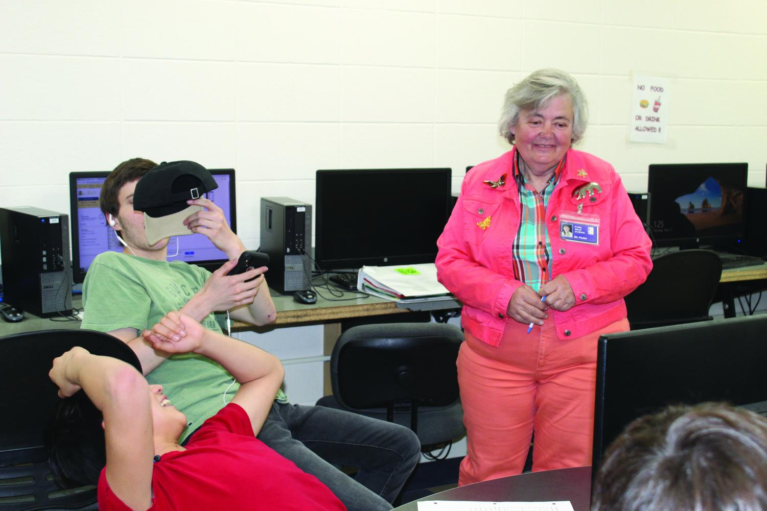 Ms. Fiedler talks with students in the computer lab while substituting recently.