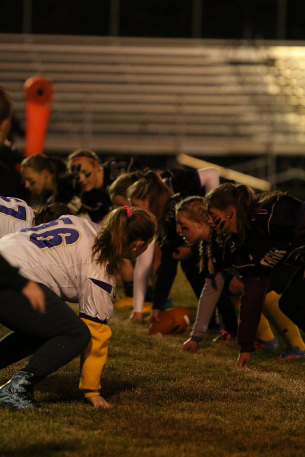 Juniors and Seniors prep for their next play in the Powder Puff football game.