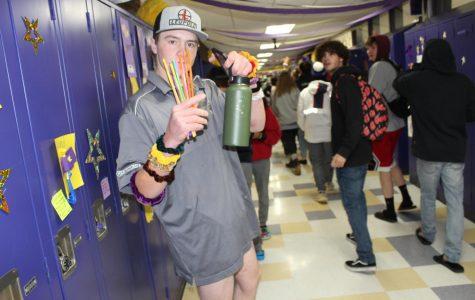 Junior McClain Payne poses with Plastic straws for VSCO girl day