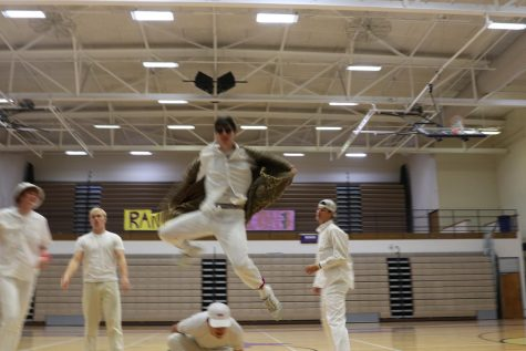 Brendon Johnson jumps over Chase Petrulis during their Back Street Boys dance routine