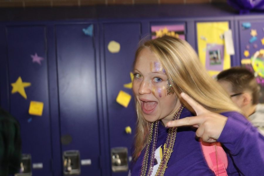 Scarlett Saile says that her favorite part of homecoming is using lots of purple and gold glitter.