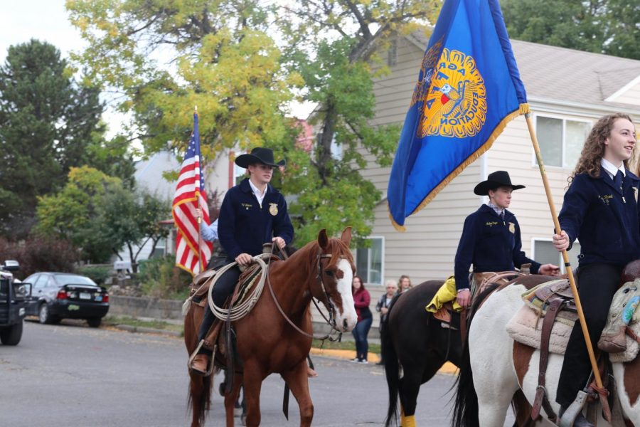 FFA+displays+flags+while+riding+their+horses+through+the+parade.+