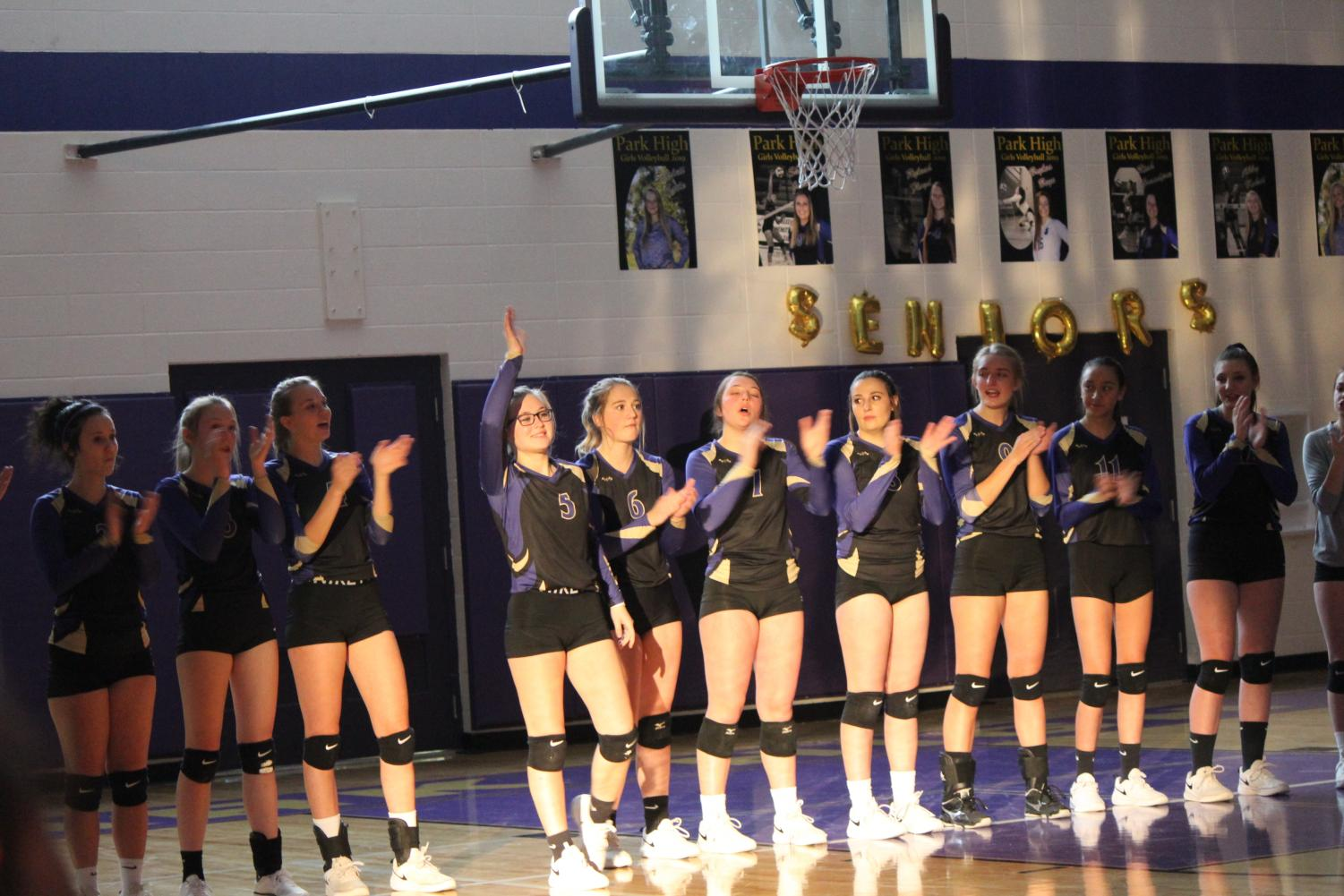 The volleyball players are introduced to the crowd before their last home game
