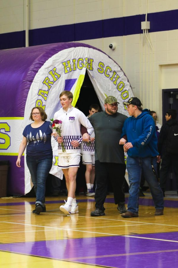 Nick Battrick and his family being recognized at the boys basketball senior night
