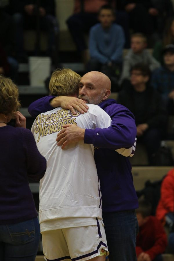 Jack Gauthier taking in an embrace from his father at the end of the senior night recognition
