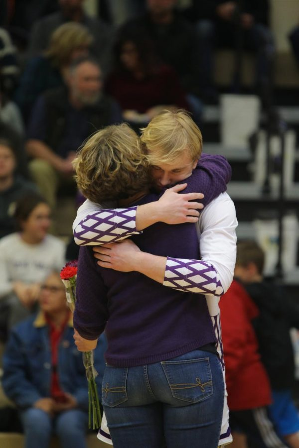 Jack+Gauthier+hugging+his+mom+after+the+boys+basketball+senior+presentation