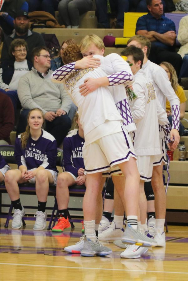 Rylee Watt and Jack Gauthier embrace in a hug before their game on senior night