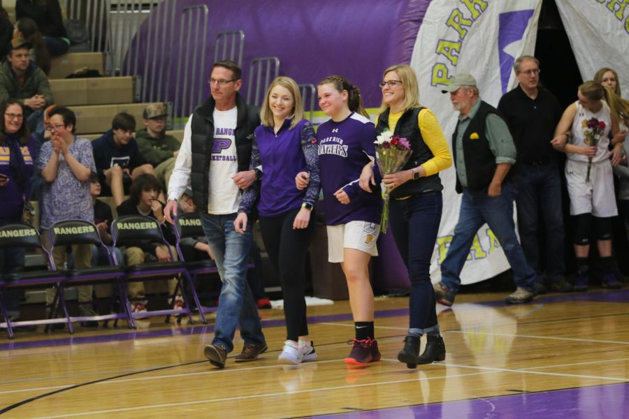 Senior Sylvie Schoenen with her parents and sister at senior night.