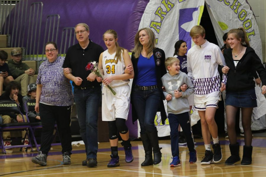 Abby Kokot walks out with her family during her senior night introduction