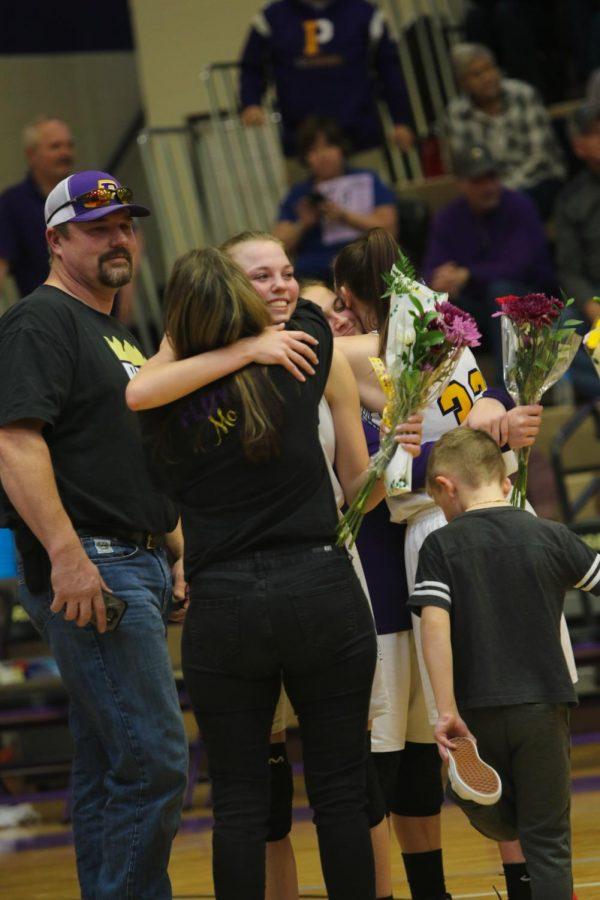 Senior Ryleah Floyd hugs her mom after senior night