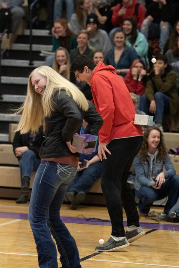 Mackenzie Watt and Sage McMinn shake their hips during the relay race.