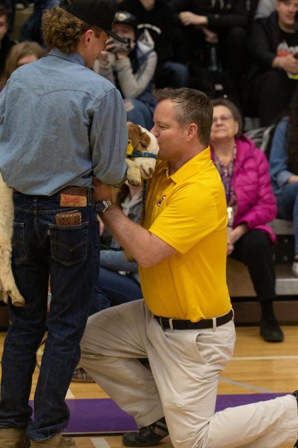 Teacher Bryan Beitel was the one chosen to kiss the mystery animal.