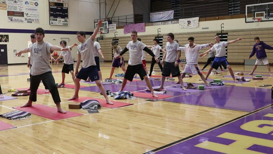 Students of the park high strength and conditioning class get their stretch on