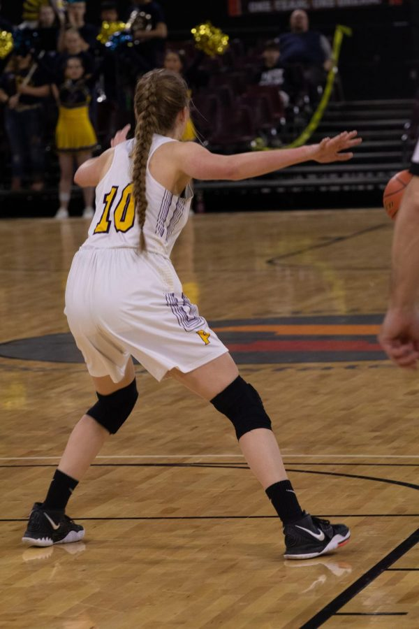 Ryleah Floyd plays defense on a Miles City competitor.