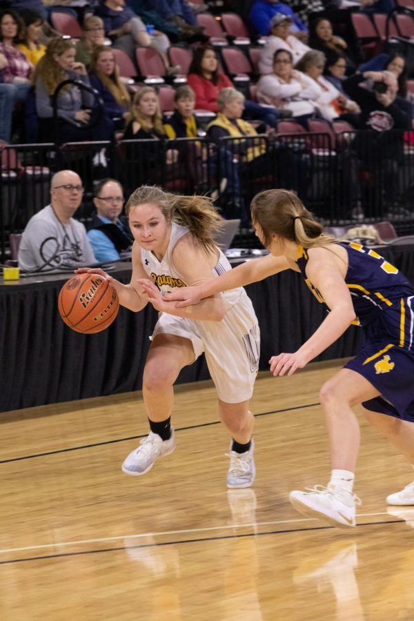 Shannon Nelson looks to drive against a Miles City defender.