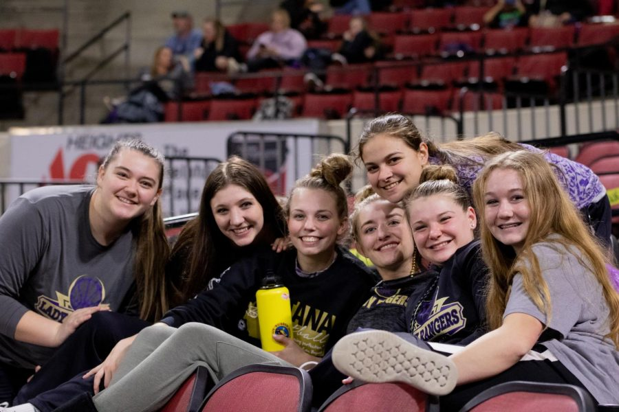 Some Park High Lady Rangers kick back while supporting the boys team on Wednesday afternoon.