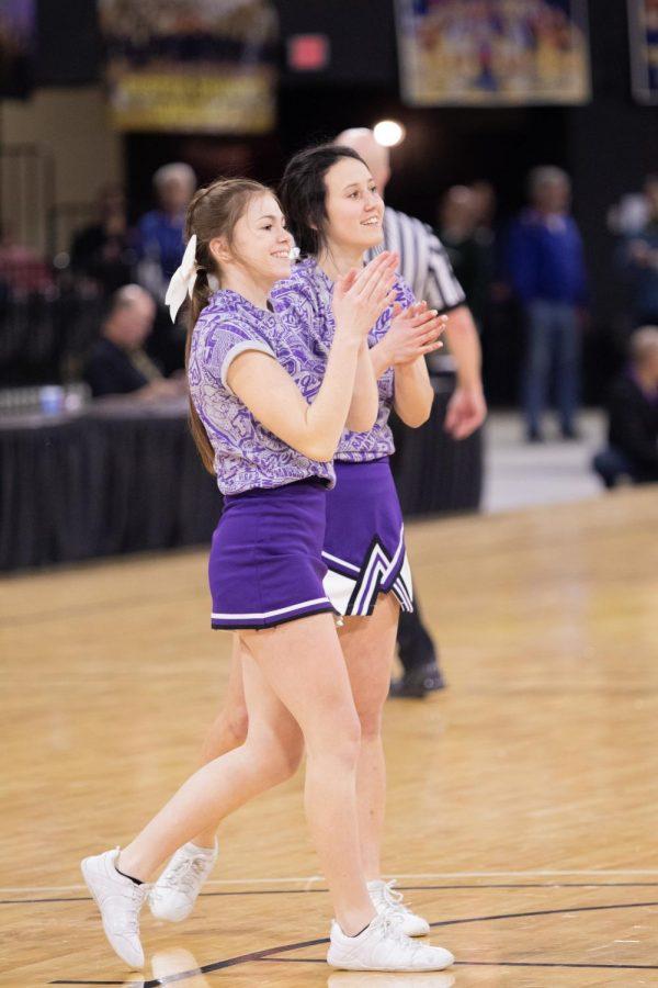 Park High Cheerleaders, Brylea Beye and Riah Grandpre cheer at Divisonals.