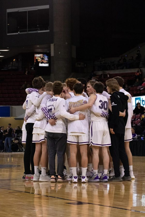 The Rangers huddle up before their games against Laurel.