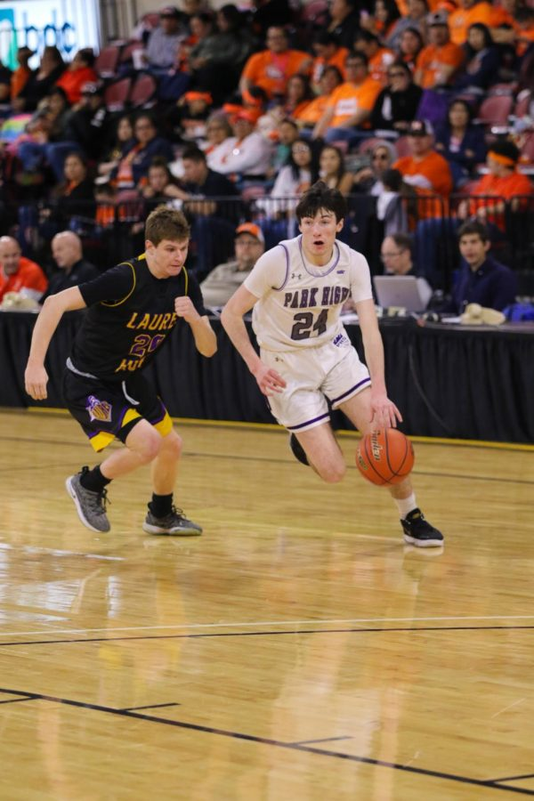Brendon Johnson dribbles around a Laurel defender as he heads to the hoop.