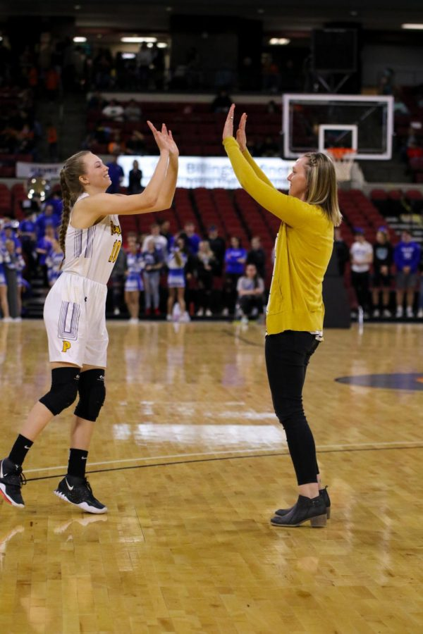 Ryleah Floyd goes in for a big high-five with her coach Megan Burns.