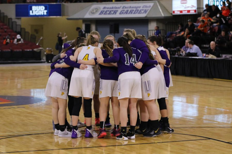 The Lady Rangers huddle up before they take on Havre on Thursday.