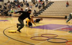 John Adams leads the pack in the Homecoming assembly relay race Wednesday, Oct. 21.
