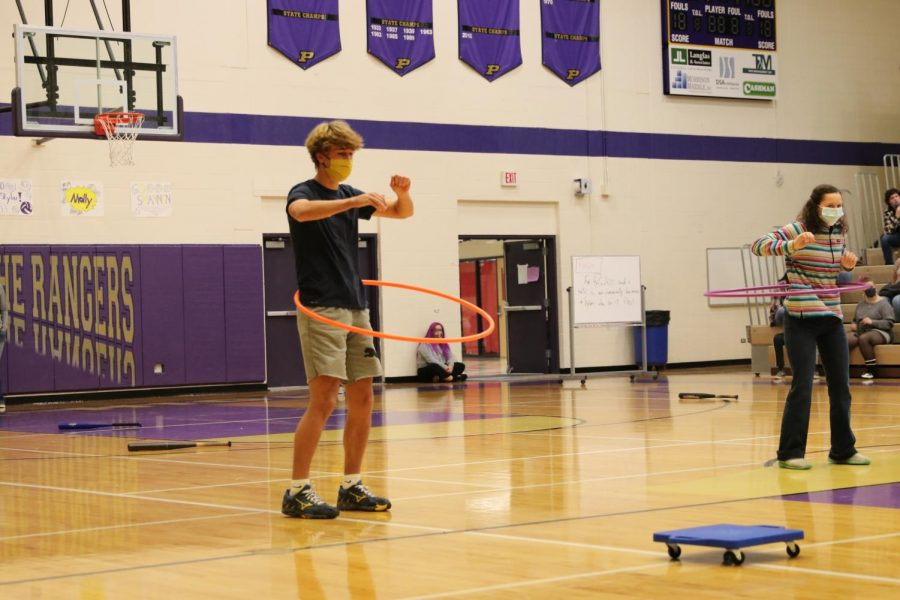 Senior Tristan Stenseth masters the hula hoop after a dizzying spin with the baseball bat.