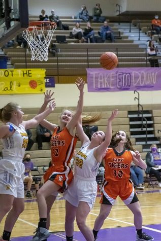 Rainna Floyd (right) and Kodie Vondra (left) fight for the rebound in the 3rd quarter against Manhattan.