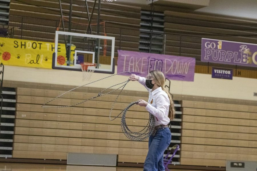 FFA Officer, Park High Sophomore Ava Malone, shows off her roping skills in a series of activity demonstrations.