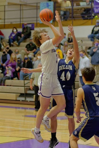 Ben Nelson takes a jumper against Dillon at home.
