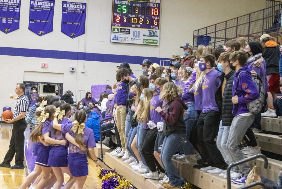 The cheerleaders rev up the student section during a timeout in the Feb. 12 Ranger Rush girls varsity game.