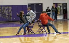 Alejandra Kaliher-Tirado,  (left), Ryan Bauer (center), and Mathias Greer (right) are among the first students to take a chance at competing in a round of musical chairs.
