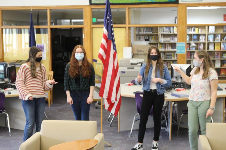Student council members prepare a video announcement March 5 to kick off back to school week.