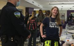 Officer Chris Gentile talks with student Jasmyn Meyer during lunch last week.
