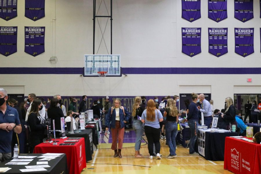 Cassidy Fletcher browses tables are the college fair.