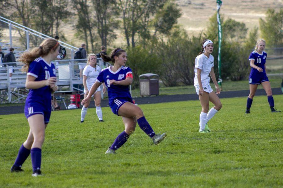 Stella Davis kicks up grass with a swift kick