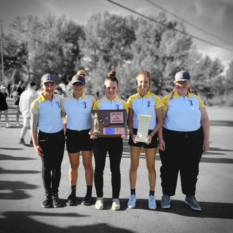 Members of the girls golf team hold the third place trophy at the state tournament in Polson.